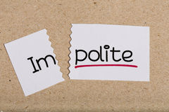 Sign with word impolite turned into polite Stock Photography