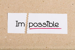 Sign with word impossible turned into possible Royalty Free Stock Image