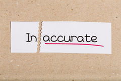 Sign with word inaccurate turned into accurate. Two pieces of white paper with the word inaccurate turned into accurate stock image