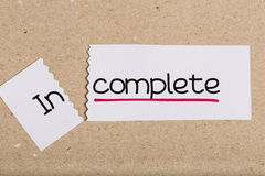 Sign with word incomplete turned into complete Royalty Free Stock Photography