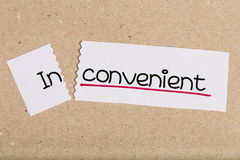 Sign with word inconvenient turned into convenient Royalty Free Stock Photos