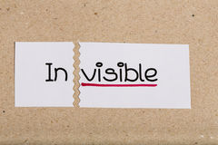 Sign with word invisible turned into visible. Two pieces of white paper with the word invisible turned into visible Royalty Free Stock Image
