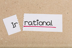 Sign with word irrational turned into rational. Two pieces of white paper with the word irrational turned into rational royalty free stock photos