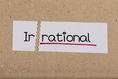 Sign with word irrational turned into rational. Two pieces of white paper with the word irrational turned into rational royalty free stock image