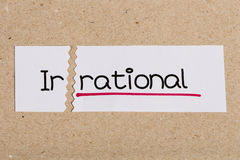 Sign with word irrational turned into rational. Two pieces of white paper with the word irrational turned into rational royalty free stock photo