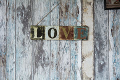 A sign with the word love on the background of old wall from boa Stock Photo