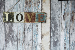 A sign with the word love on the background of old wall from boa Stock Images