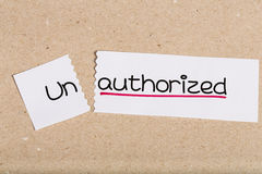 Sign with word unauthorized turned into authorized Stock Photo