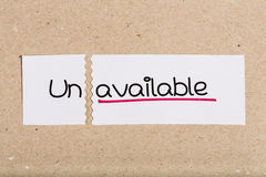 Sign with word unavailable turned into available Royalty Free Stock Image