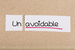 Sign with word unavoidable turned into avoidable Royalty Free Stock Photo