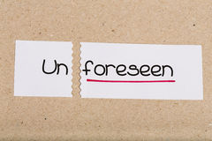 Sign with word unforeseen turned into foreseen