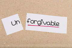 Sign with word unforgivable turned into forgivable Stock Images