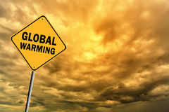 Sign with words 'Global warming' and thunderclouds Stock Photo