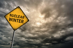Sign with words 'Nuclear winter' and thunderclouds Stock Photos