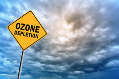 Sign with words 'Ozone depletion' and thunderclouds Stock Photo