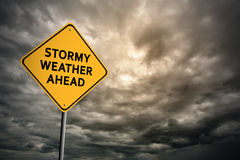 Sign with words 'Stormy weather ahead' and thunderclouds Stock Image