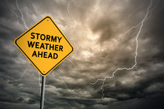 Sign with words 'Stormy weather ahead' and thunderclouds Stock Photo