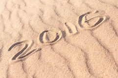 Sign 2016 written on sandy beach. Summer travel concept Royalty Free Stock Image