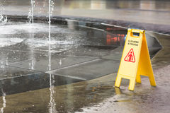 Sign. A yellow cleaning sign at fountain Royalty Free Stock Photo