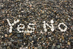 The sign Yes No made from white pebbles. On pebble beach on the sea Stock Images