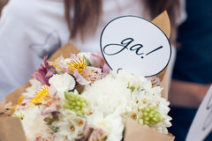 Sign Yes in a wedding bouquet Stock Images
