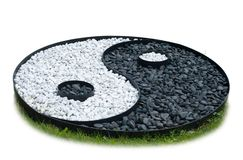 Sign of yin yang laid out of black and white stones isolated on white background stock image