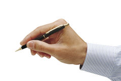 Sign your life away. Mans hand holding ball point pen,blue pinstriped shirt, isolated Royalty Free Stock Photography