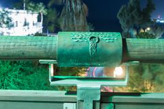 Sign of the zodiac Aquarius on the bridge of the Wishing Bridge in the green light of a spotlight located on old city Yafo in Tel. Tel Aviv-Yafo, Israel royalty free stock photo
