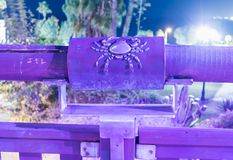 Sign of the zodiac Cancer on the bridge of the Wishing Bridge in the violet light of a spotlight located on old city Yafo in Tel A. Tel Aviv-Yafo, Israel stock photos