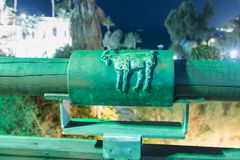 Sign of the zodiac Capricorn on the bridge of the Wishing Bridge in the green light of a spotlight located on old city Yafo in Tel. Tel Aviv-Yafo, Israel stock photography