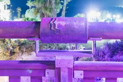 Sign of the zodiac Gemini on the bridge of the Wishing Bridge in the violet light of a spotlight located on old city Yafo in Tel A. Tel Aviv-Yafo, Israel royalty free stock image