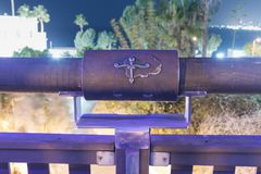 Sign of the zodiac Libra on the bridge of the Wishing Bridge in the violet light of a spotlight located on old city Yafo in Tel Av. Tel Aviv-Yafo, Israel Royalty Free Stock Photography