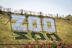 Sign zoo. On Hill Grass Royalty Free Stock Photos