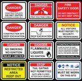 Signage, ícones e s de advertência da segurança do local da construção civil Fotografia de Stock