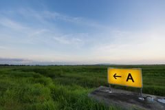 Signage on airport runway Stock Photo