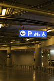 Signage and arrow show direction at indoor car park area. Royalty Free Stock Image