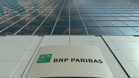 Signage board with BNP Paribas logo. Modern office building facade. Editorial 3D rendering Stock Image