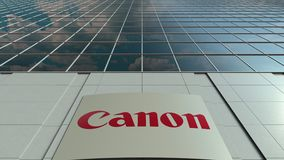 Signage board with Canon Inc. logo. Modern office building facade time lapse. Editorial 3D rendering. Outdoor signage board with Canon Inc. logo. Modern office stock video