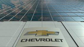 Signage board with Chevrolet logo. Modern office building facade time lapse. Editorial 3D rendering