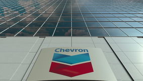 Signage board with Chevron Corporation logo. Modern office building facade. Editorial 3D rendering. Outdoor signage board with Chevron Corporation logo. Modern Stock Photography