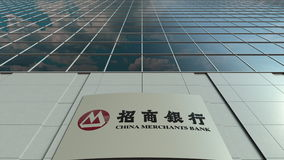 Signage board with China Merchants Bank logo. Modern office building facade. Editorial 3D rendering Royalty Free Stock Photography