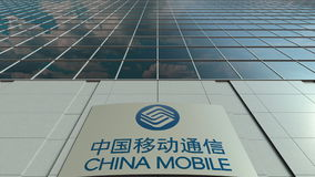 Signage board with China Mobile logo. Modern office building facade. Editorial 3D rendering Stock Photo