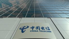 Signage board with China Telecom logo. Modern office building facade time lapse. Editorial 3D rendering