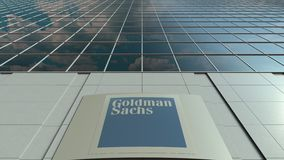 Signage board with The Goldman Sachs Group, Inc. logo. Modern office building facade time lapse. Editorial 3D rendering