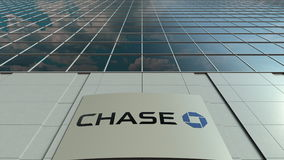 Signage board with JPMorgan Chase Bank logo. Modern office building facade. Editorial 3D rendering. Outdoor signage board with JPMorgan Chase Bank logo. Modern Stock Image