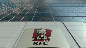 Signage board with Kentucky Fried Chicken KFC logo. Modern office building facade time lapse. Editorial 3D rendering