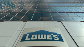 Signage board with Lowe`s logo. Modern office building facade. Editorial 3D rendering Stock Images
