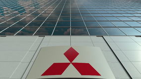 Signage board with Mitsubishi logo. Modern office building facade. Editorial 3D rendering stock image