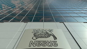 Signage board with Nestle logo. Modern office building facade. Editorial 3D rendering. Outdoor signage board with Nestle logo. Modern office building. Editorial Stock Images