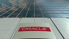 Signage board with Oracle Corporation logo. Modern office building facade. Editorial 3D rendering. Outdoor signage board with Oracle Corporation logo. Modern Royalty Free Stock Image